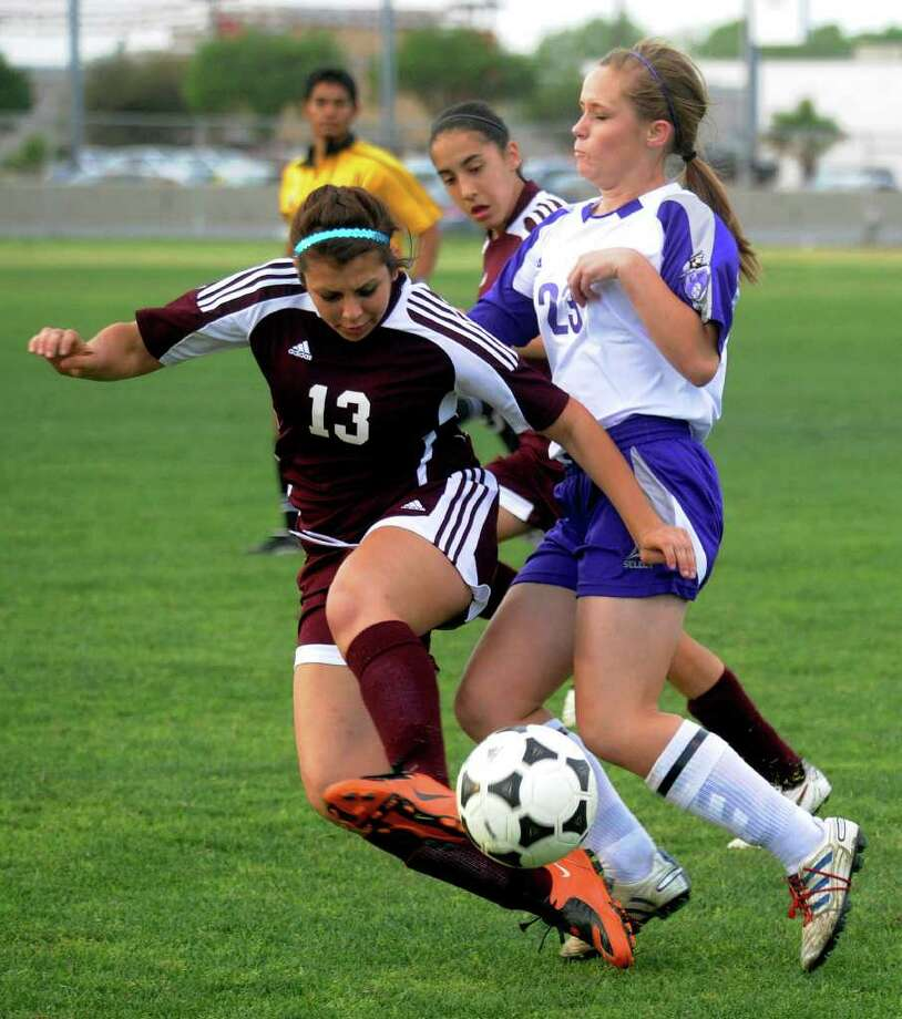 Warren's Megan Jefferies (23) — seen here fighting for the ball with Marshall's Brianna Brune (13) in March 2011 — tallied four goals and two assists as the Warriors finished second at the McAllen tournament, including scoring three goals during a 3-2 victory against perennial regional-tournament qualifier Harlingen South. Photo: San Antonio Express-News, Billy Calzada / gcalzada@express-news.net