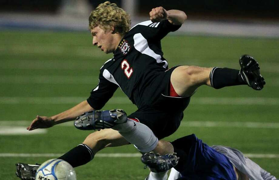 Churchill's Zach Berger — seen here being tripped up against New Braunfels in April 2011 — scored two game-winning goals on Saturday, including one with 33 seconds remaining in the final against District 26-5A foe Johnson, as the Chargers won the North East tournament championship. Photo: San Antonio Express-News, Tom Reel / © 2011 San Antonio Express-News