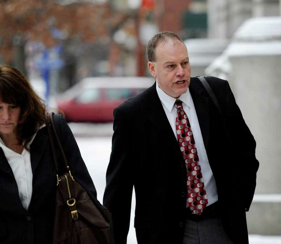 Rensselaer County Elections Commissioner Edward G. McDonough enters the Rensselaer County Courthouse for jury selection in a ballot fraud trial which is moving forward in Troy, New York, Tuesday,  Jan. 17, 2012. (Skip Dickstein / Times Union) Photo: SKIP DICKSTEIN / 2012