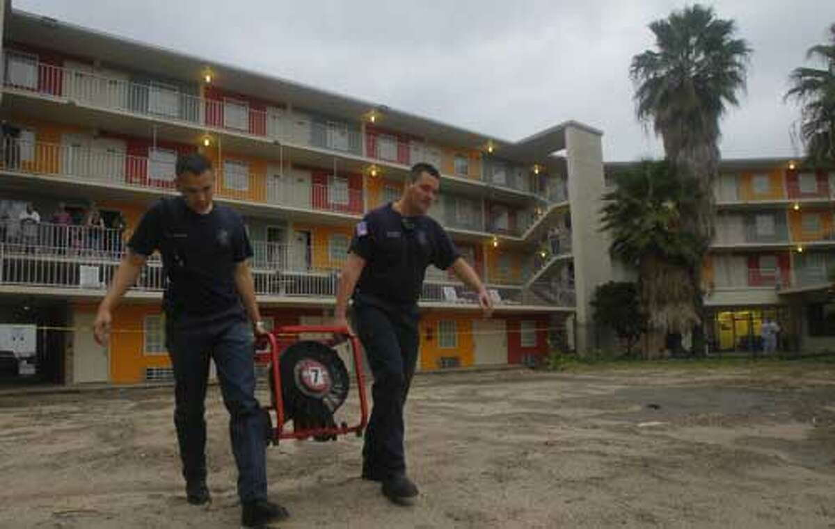 Firefighters leave after containing an explosion at Travis Street Plaza. (Cody Duty/Chronicle)