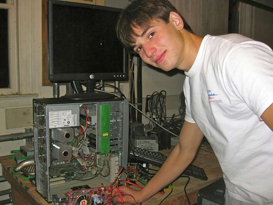 Alex Mauboussin began refurbishing computers with his brother Andrew after they realized how much computers make certain aspects of their lives, such as school work, much easier. Photo: Contributed Photo