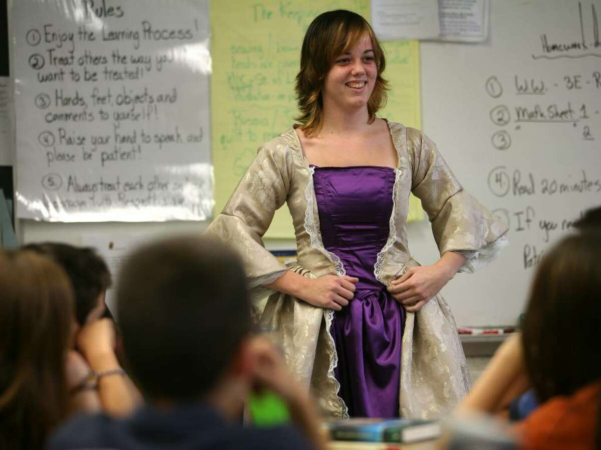 Fairfield Warde junior Danielle Weston models the colonial era dress the she made during her presentation at Stratfield Elementary School in Fairfield, Conn. on Tuesday, October 27, 2009.