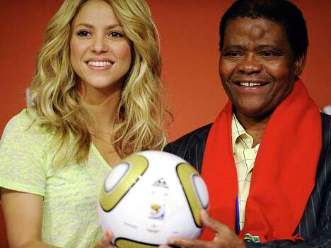 Colombian singer Shakira (L) and Joseph Shabalala, music director of Grammy Award winners Ladysmith Black Mambazo and founder of the prize, hold the Jo'bulani football that will be used for the final during a press conference on July 10, 2010 at Soccer City Stadium in Soweto, suburb of Johannesburg, on the eve of the 2010 World Cup final between The Netherlands and Spain. Photo: STEPHANE DE SAKUTIN, Getty Images