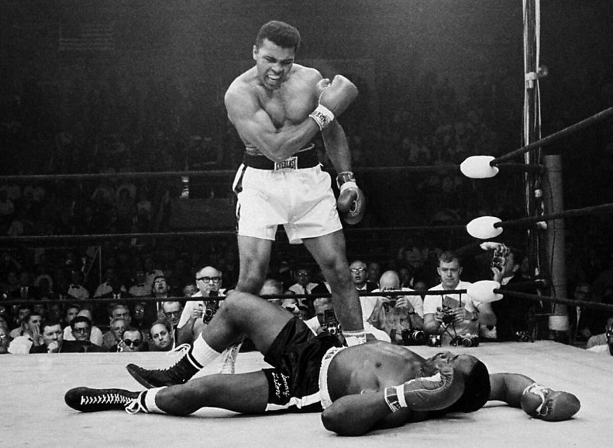 FILE - In this May 25, 1965, file photo, heavyweight champion Muhammad Ali stands over fallen challenger Sonny Liston, after dropping Liston with a short hard right to the jaw in Lewiston, Maine.