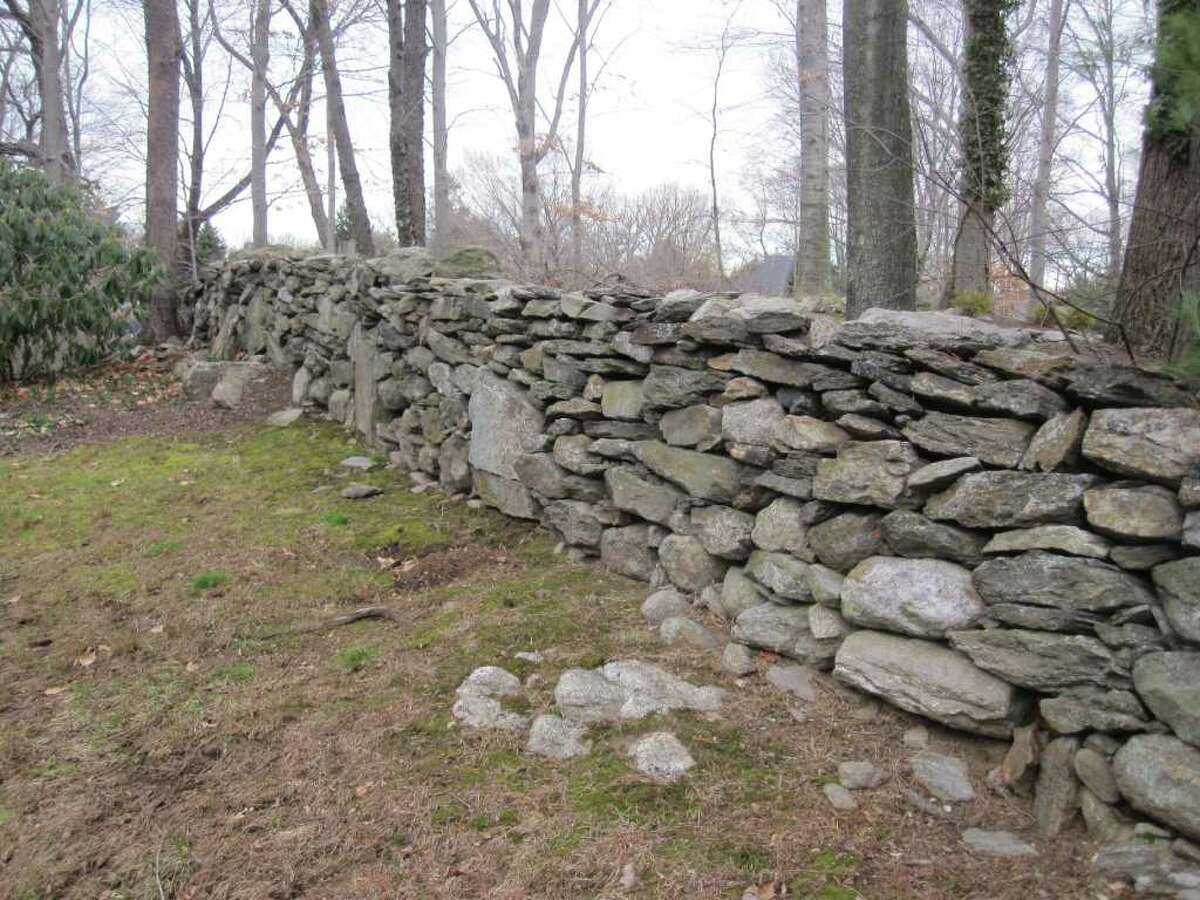A stone wall on the author's property in Fairfield is just a small stretch of an estimated 250,000 miles of stone walls built by early settlers in Northeast states.