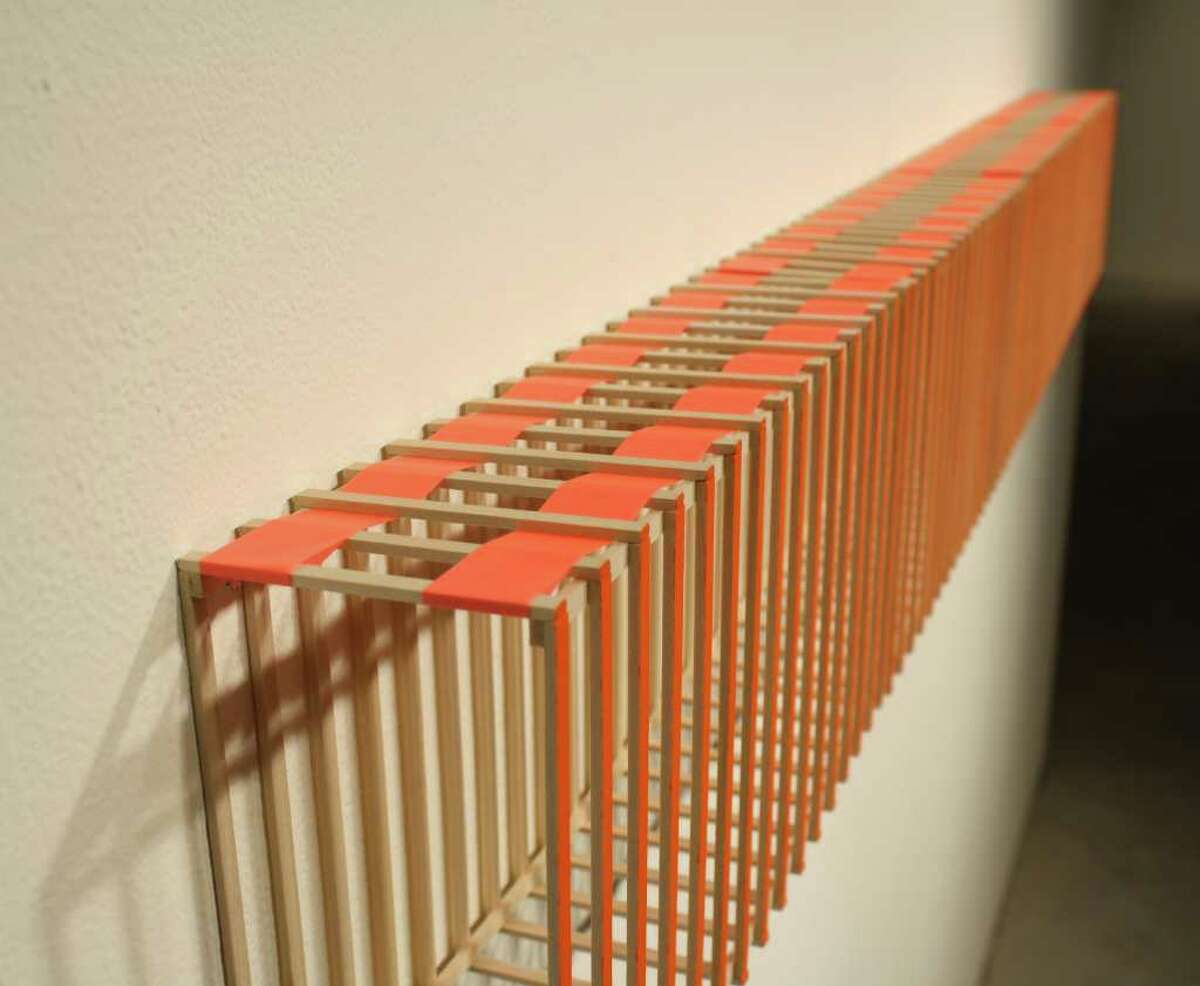 """Brian R. Jobe's """"Channel Modules,"""" part of the """"Land Portrait"""" exhibit, was inspired by highways and caution colors."""