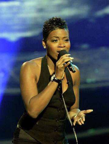 "Fantasia Barrino sings ""Impossible Dream"" during the ""American Idol"" live finale, Wednesday, May 26, 2004, in Los Angeles.  (AP Photo/Kevork Djansezian)  HOUCHRON CAPTION (05/27/2004):  With a record 65 million votes cast, America elected Fantasia Barrino of North Carolina the winner of the third edition of American Idol. Photo: KEVORK DJANSEZIAN, STF / AP"