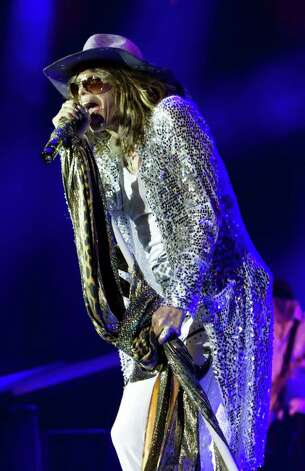 Aerosmith's Steven Tyler performs during their concert at the Cynthia Woods Mitchell Pavilion Friday, July 17, 2009, The Woodlands.  ( Brett Coomer / Chronicle ) Photo: Brett Coomer, Staff / Houston Chronicle