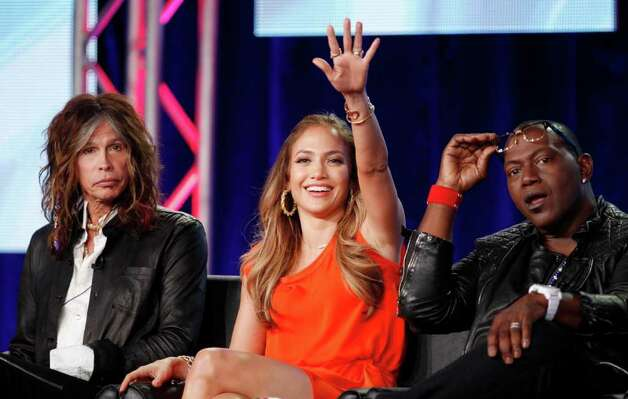 American Idol judges, from left to right, Steven Tyler, Jennifer Lopez, and Randy Jackson, look towards a person asking a question during the American Idol panel at the Fox Broadcasting Company Television Critics Association Winter Press Tour in Pasadena , Calif. on Sunday, Jan. 8, 2012. (AP Photo/Danny Moloshok) Photo: Danny Moloshok, FRE / R-MOLOSHOK