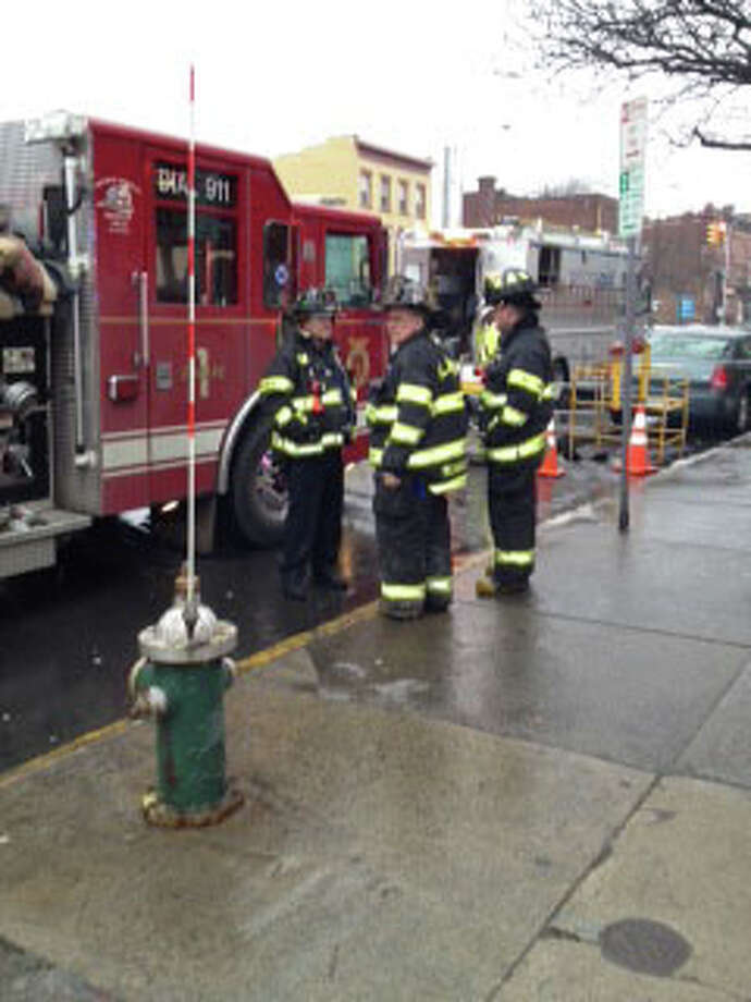 Albany firefighters gather outside 97 Central Ave., on Tuesday, Jan. 17, 2012, to investigate what caused smoke to fill the building's basement. (PAUL GRONDAHL / TIMES UNION)