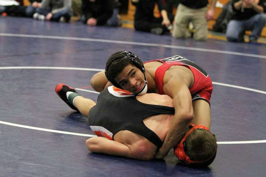 Warde's Pharoh Eaton takes care of a competitor at the Merrimack Invitational in New Hampshire. Eaton won the 132-pound weight class at the invitational. Photo: Contributed Photo