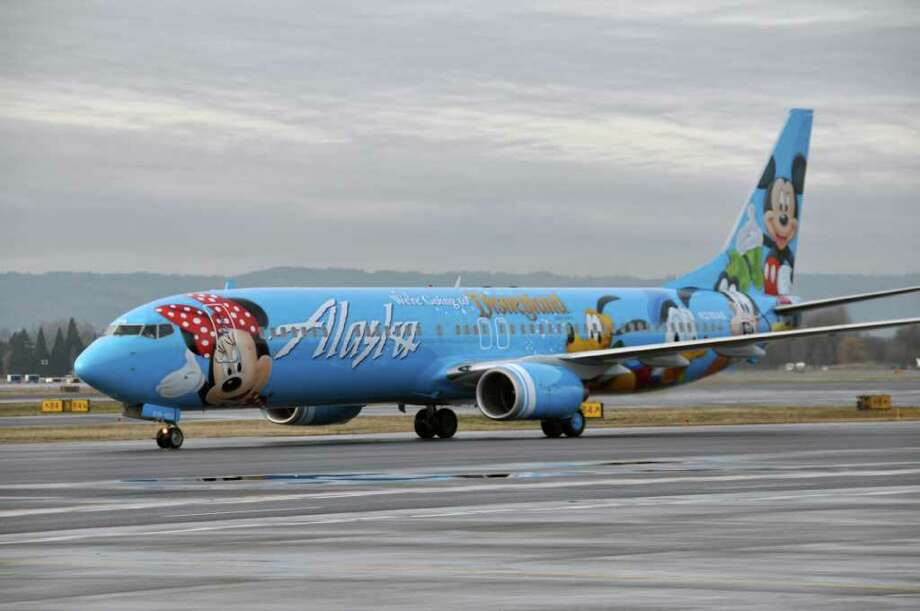"""Earlier this year, German airline Condor rolled out this Boeing 767 decorated with characters from German children's book author Janosch.Janosch's little tiger, bear and """"Tigerduck"""" draw attention to Condor's fundraising campaign for German relief agency BILD hilft e.V. -- A Heart for Children, which supports children in need in Germany and  other countries. Photo: Alaska Airlines"""