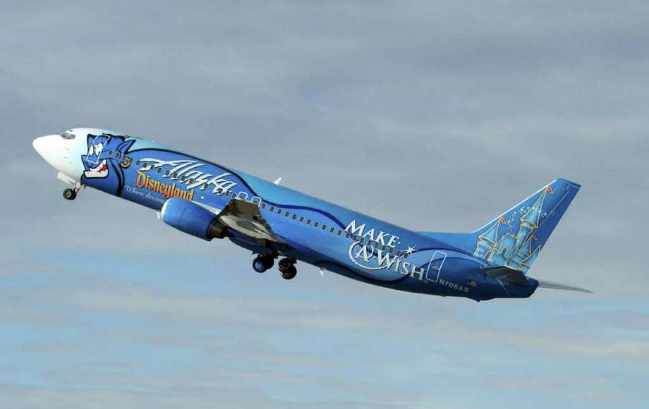 "... Fortunately, Alaska Airlines rolled out its new ""Salmon-Thirty-Salmon II"" Boeing 737-800 last year. Photo: Alaska Airlines"