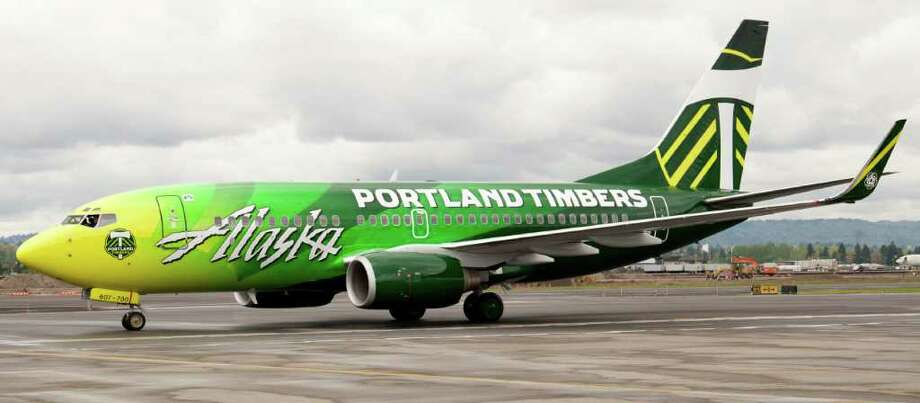 "This followed up on Finnair's Airbus 330 with a livery based on the Marimekko print Unikko (""poppy""), rolled out in October 2012. Photo: Miranda Chrislock/Portland Timbers, Alaska Airlines / Miranda Chrislock 2011"