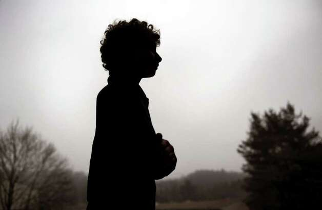 Twelve-year-old Ryan Rodriguez is silhouetted against a hazy sky outside his Ansonia home Tuesday, Jan. 17, 2012.  Rodriguez was bullied in a New Haven magnet school because of his race and has since changed schools. Photo: Autumn Driscoll / Connecticut Post