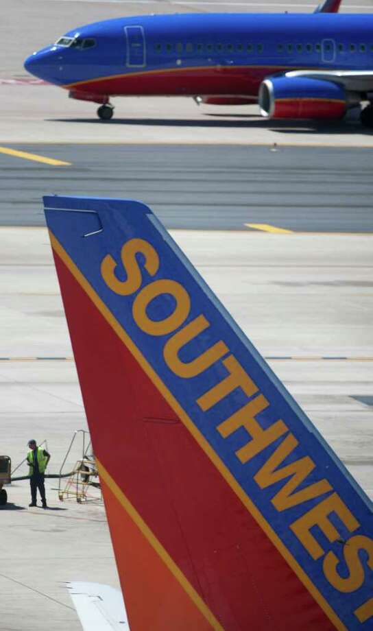Dallas-based Southwest Airlines Co. plans to move and expand its San Antonio customer service center — adding 322 new jobs for a total of at least 800 and investing $4 million in a new location — under a tentative incentive agreement with the city of San Antonio. Photo: AP