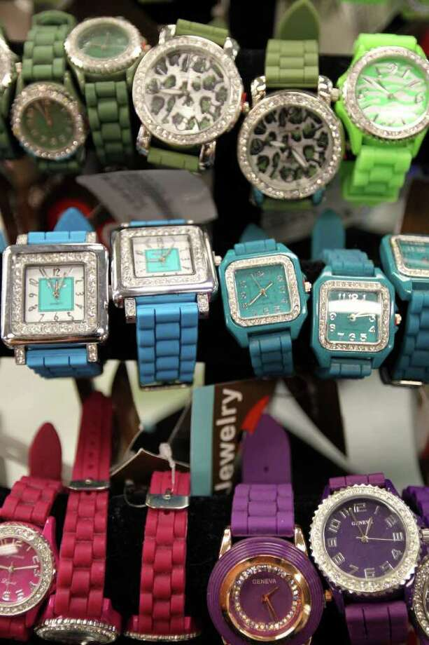 Watches for sale at Plato's Closet at North Park Mall, Monday, January 16, 2012. The franchise buys gently used merchandise that would appeal to the teen to twenty-something demographic and sells them at about 70% of retail cost, paying sellers 35% of their floor price. Photo: JENNIFER WHITNEY, Special To The Express-News / special to the Express-News
