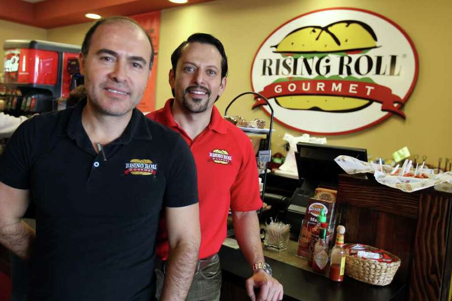 Polo Bustos, general manager, and Carlos Gonzalez , owner, at Rising Roll Gourmet, Monday, January 16, 2012. Photo: JENNIFER WHITNEY, Special To The Express-News / special to the Express-News