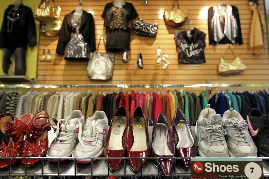 Shoes for sale at Plato's Closet at North Park Mall, Monday, January 16, 2012. The franchise buys gently used merchandise that would appeal to the teen to twenty-something demographic and sells them at about 70% of retail cost, paying sellers 35% of their floor price. Photo: JENNIFER WHITNEY, Special To The Express-News / special to the Express-News