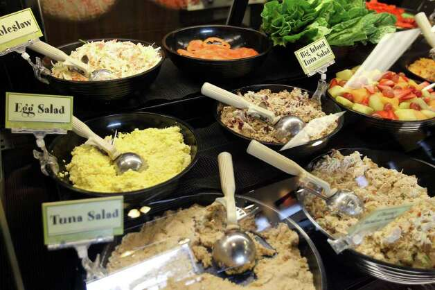 Salads in the deli case at Rising Roll Gourmet, Monday, January 16, 2012. Photo: JENNIFER WHITNEY, Special To The Express-News / special to the Express-News