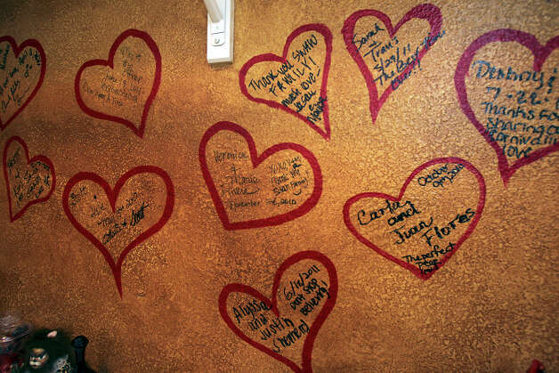 Couples leave notes on the heart wall as the Swan family runs a wedding planning business out of their estate near Grey Forest. January 12, 2012 Tom Reel/Staff Photo: TOM REEL, SAN ANTONIO EXPRESS-NEWS / © 2012 San Antonio Express-News MAGS OUT; TV OUT; NO SALES; SAN ANTONIO OUT; AP MEMBERS ONLY; MANDATORY CREDIT; EFE OUT