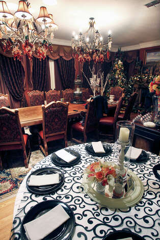 An elaborate dining room can be used as the Swan family runs a wedding planning business out of their estate near Grey Forest. January 12, 2012 Tom Reel/Staff Photo: TOM REEL, SAN ANTONIO EXPRESS-NEWS / © 2012 San Antonio Express-News MAGS OUT; TV OUT; NO SALES; SAN ANTONIO OUT; AP MEMBERS ONLY; MANDATORY CREDIT; EFE OUT