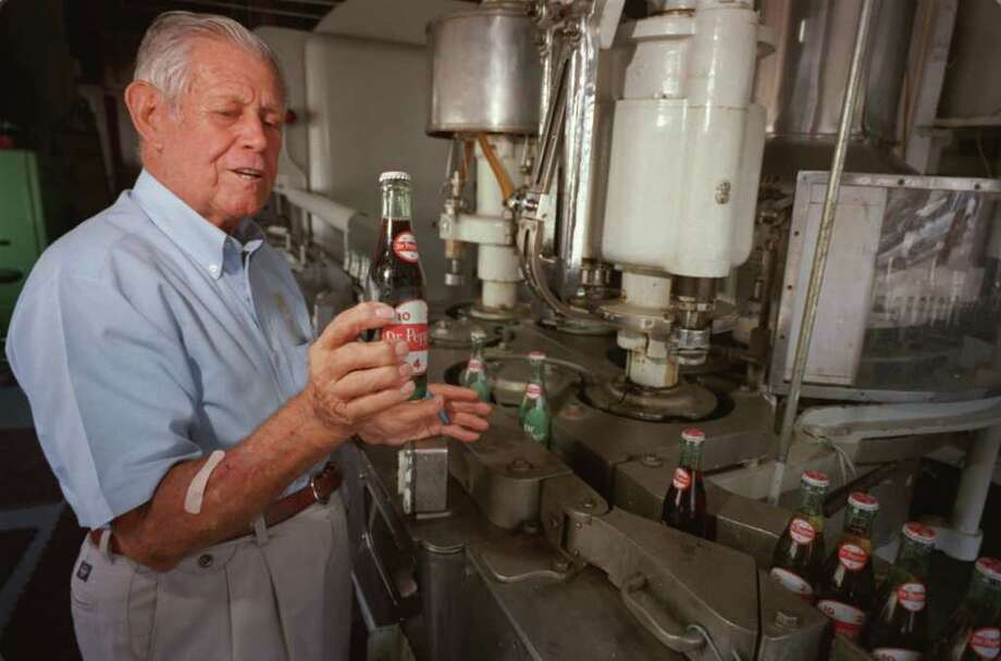 In this 1998 photo, Bill Kloster, 80, explains the bottling process at the Dublin Dr. Pepper bottling plant and museum. Photo: Steve Ueckert / Houston Chronicle