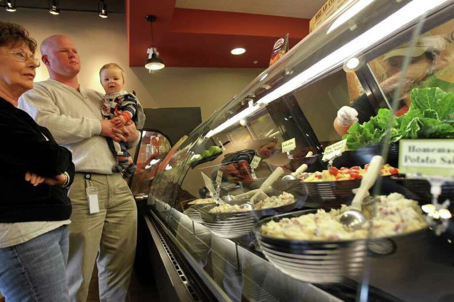 Customers go through the sandwich preparation line at Rising Roll Gourmet, Monday, January 16, 2012. Photo: JENNIFER WHITNEY, Special To The Express-News / special to the Express-News