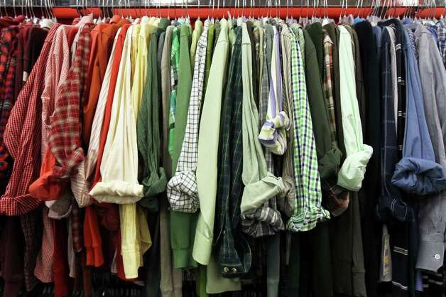 Men's shirts for sale at Plato's Closet at North Park Mall, Monday, January 16, 2012. The franchise buys gently used merchandise that would appeal to the teen to twenty-something demographic and sells them at about 70% of retail cost, paying sellers 35% of their floor price. Photo: JENNIFER WHITNEY, Special To The Express-News / special to the Express-News