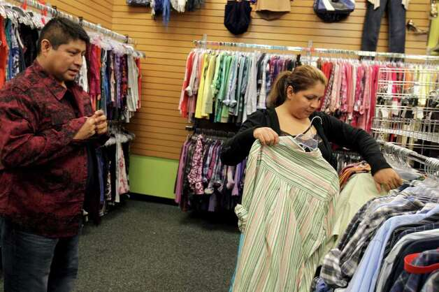 Customers browse the men's clothing at Plato's Closet at North Park Mall, Monday, January 16, 2012. The franchise buys gently used merchandise that would appeal to the teen to twenty-something demographic and sells them at about 70% of retail cost, paying sellers 35% of their floor price. Photo: JENNIFER WHITNEY, Special To The Express-News / special to the Express-News