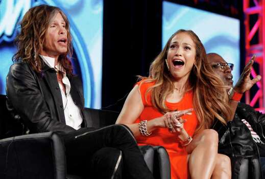 American Idol judge Jennifer Lopez reacts as fellow judge Steven Tyler, left, of Aerosmith makes a joke about wearing Lopez's pants as Randy Jackson is seen at right during the American Idol panel at the Fox Broadcasting Company Television Critics Association Winter Press Tour in Pasadena , Calif. on Sunday, Jan. 8, 2012. (AP Photo/Danny Moloshok) Photo: Danny Moloshok / R-MOLOSHOK