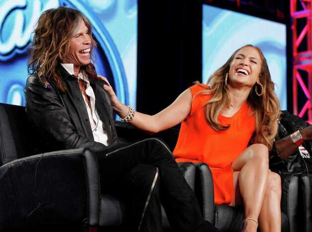 American Idol judge Jennifer Lopez reacts as fellow judge Steven Tyler, left, of Aerosmith makes a joke about wearing Lopez's during the American Idol panel at the Fox Broadcasting Company Television Critics Association Winter Press Tour in Pasadena , Calif. on Sunday, Jan. 8, 2012. (AP Photo/Danny Moloshok) Photo: Danny Moloshok / R-MOLOSHOK