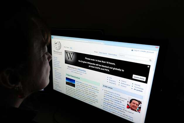 A journalist reads information on the online encyclopedia Wikipedia on Jauary 17, 2012 in Washington, DC. Free online knowledge site Wikipedia will shut down for 24 hours beginning at midnight eastern standard time in protest at draft anti-online piracy legislation before the US Congress, founder Jimmy Wales said Monday on Twitter.   AFP PHOTO/Karen BLEIER (Photo credit should read KAREN BLEIER/AFP/Getty Images) Photo: Karen Bleier, AFP/Getty Images