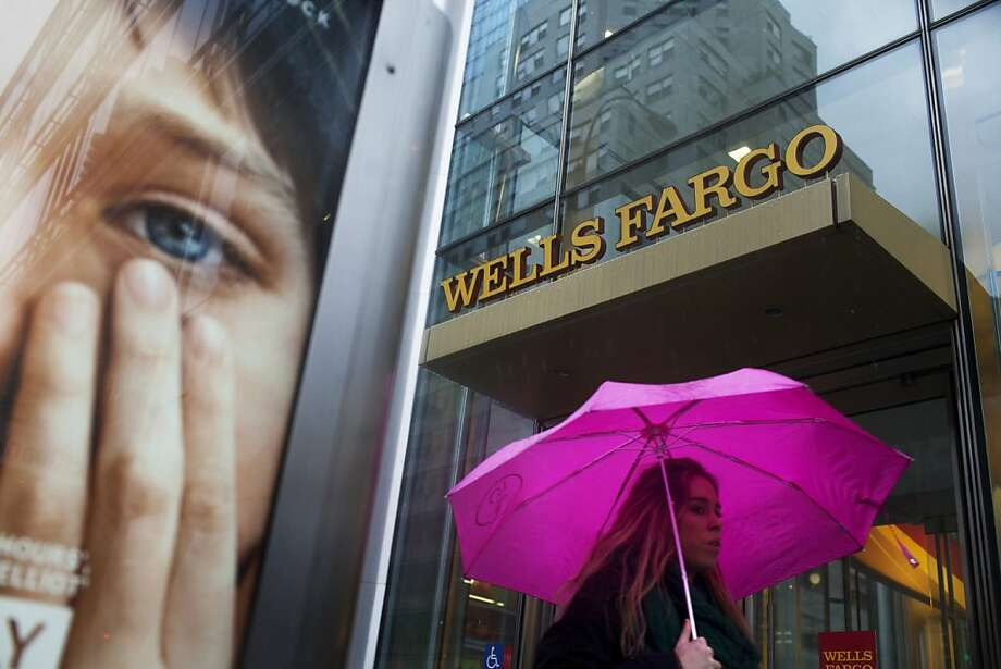 A woman walks past a Wells Fargo & Co. bank branch in New York, U.S., on Tuesday, Jan. 17, 2012. Wells Fargo & Co., the largest U.S. bank by market value, posted record profit for the fourth quarter and full year that beat analysts' estimates as mortgage financing improved. Photographer: Victor J. Blue/Bloomberg Photo: Victor J. Blue, Bloomberg