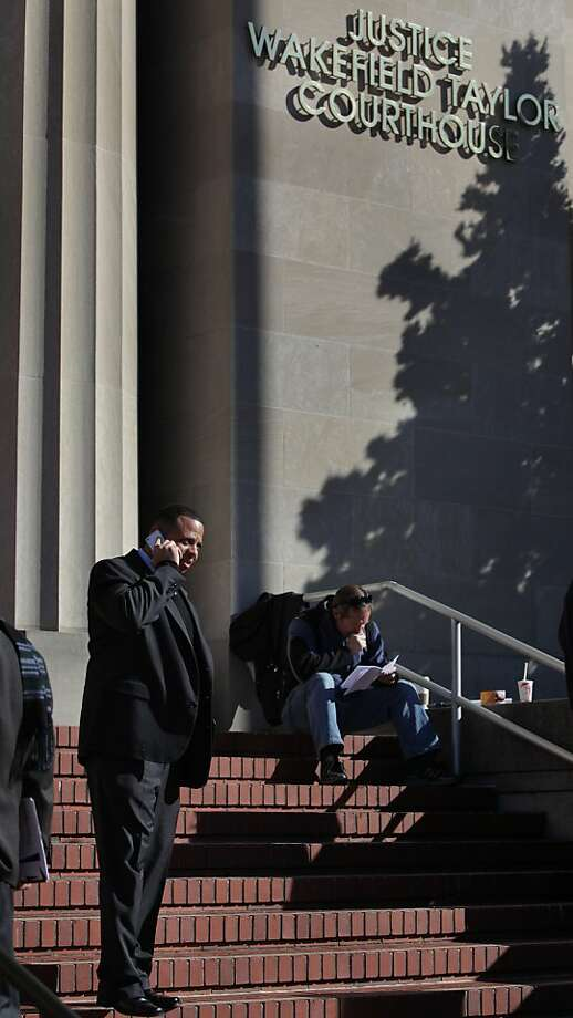 Lt. Shawn Pickett  (left) talks on the phone as he walks down the front steps of the Justice Wakefield Taylor Courthouse on Tuesday, January 17, 2012 in Martinez, Calif. Photo: Lea Suzuki, The Chronicle