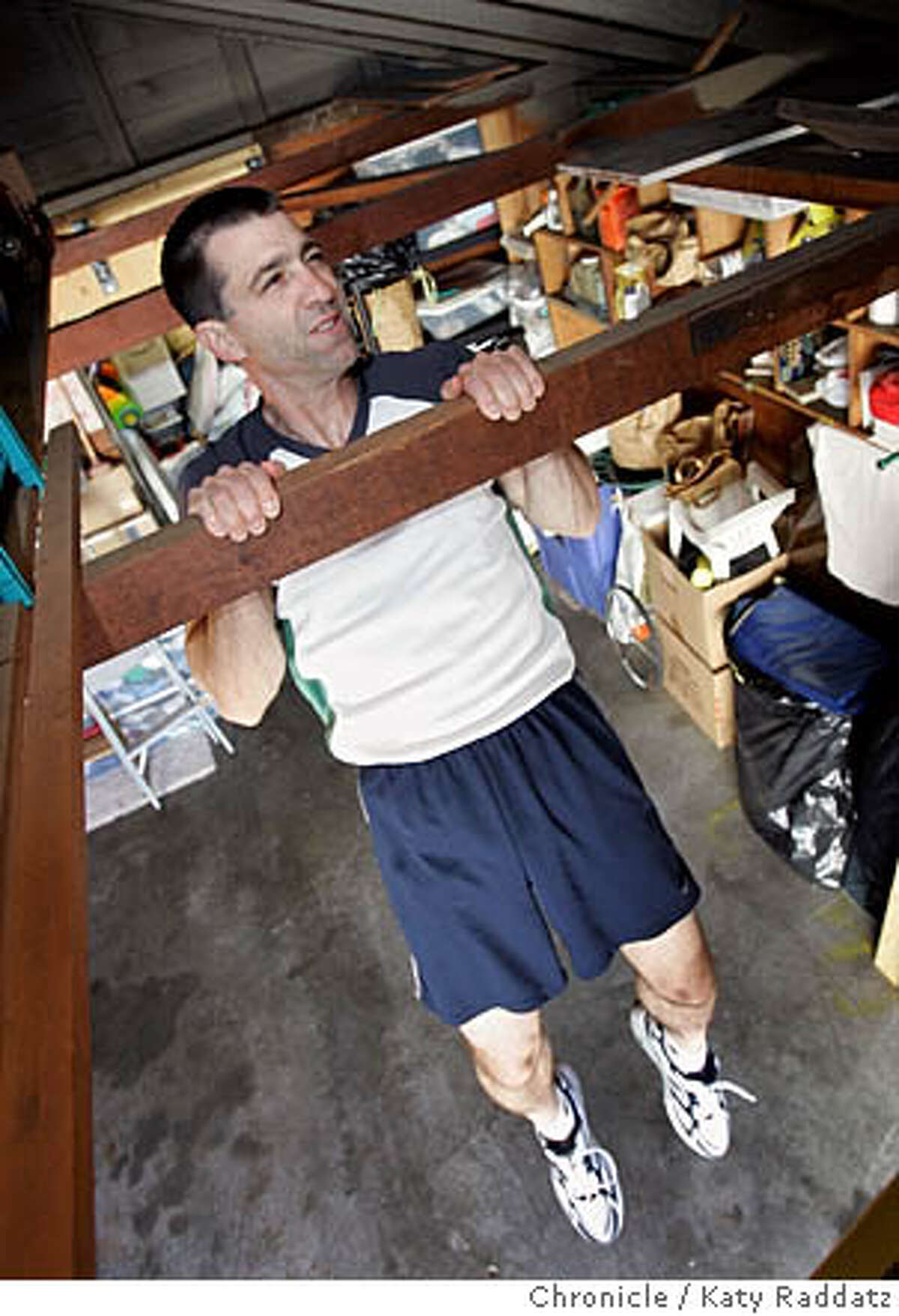 Guy Schott has set a record for pullups. He is shown in his garage, doing pullups on the very beam that he began doing pullups on. Photo taken on 11/20/05, in Santa Rosa, CA. By Katy Raddatz / The San Francisco Chronicle
