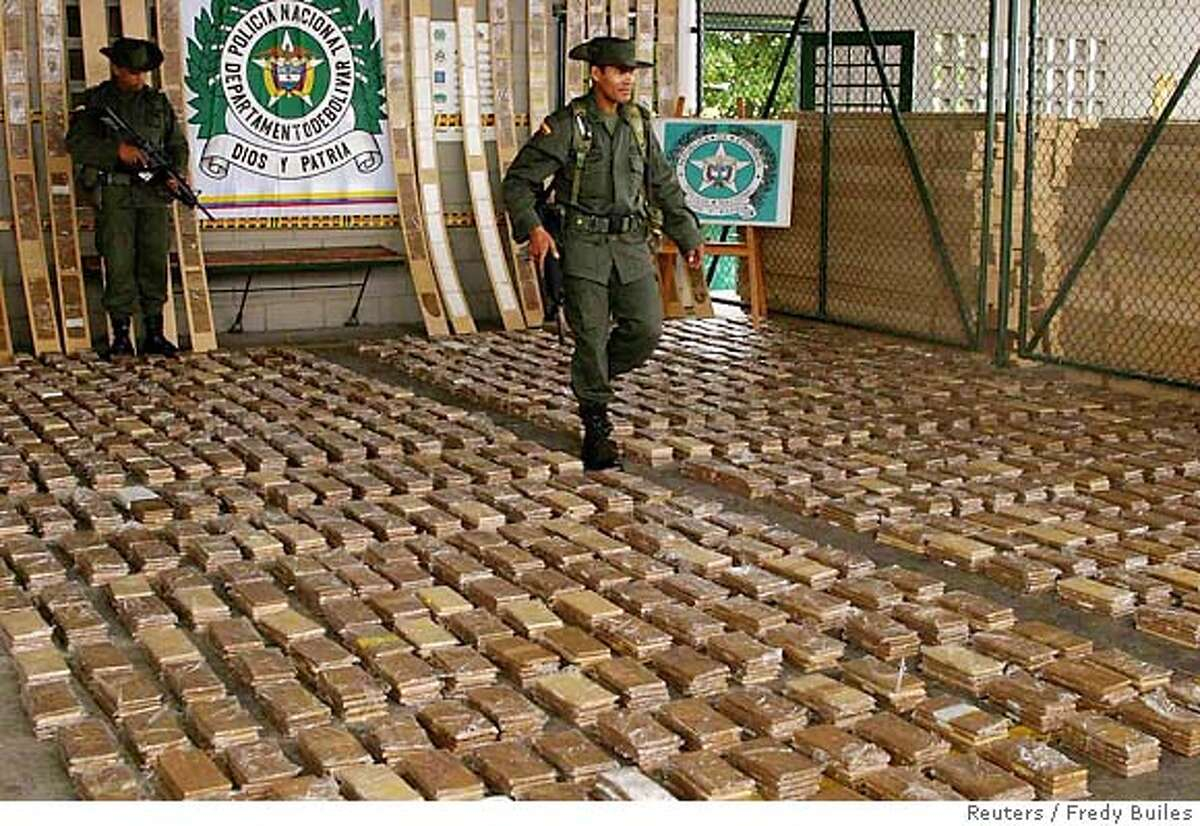 A Colombian anti drugs policeman walks amid a cocaine load confiscated in the Caribbean port of Cartagena, Colombia, November 22, 2005. Colombian police seized at least 821 kgs of cocaine bound for Mexico. REUTERS/Fredy Builes Ran on: 12-07-2005 A Colombian antidrug officer walks amid more than 1,800 pounds of cocaine seized at the port of Cartagena last month. Ran on: 12-07-2005 A Colombian antidrug officer walks amid more than 1,800 pounds of cocaine seized at the port of Cartagena last month.
