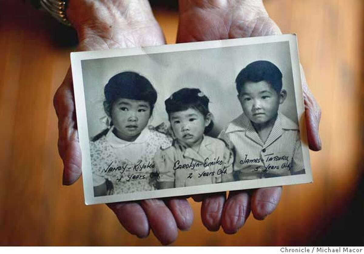 tanforan02_009_mac.jpg May Tanabe holds a photograph of her 3 children taken in July 1946 on Nancy's (left) birthday when she turned 4 years old. Nancy Tanabe Belluomini was born in Tanforan on July 27, Her mother May Tanabe is now 85 years old. Sixty five years ago this summer, thousands Japanese Americans were forced from their Bay Area homes and lodged temporarily at the Tanforan racetrack before they were interned by the U.S. government. Between May and October 1942, about 50 babies were born at the racetrack, now a shopping mall � and this Saturday, there will be a reunion at Tanforan to remind people of the injustices they experienced and to honor former internees who have died. None of the Tanforan babies � now with kids and grandkids of their own � remember the racetrack or the filthy stables where their families slept. But they remember their parents� stories � and that generation�s struggle over talking about what happened. (cq) Nancy Tanabe Belluomini, May Tanabe. Photographed in, San Francisco, Ca, on 5/31/07. Photo by: Michael Macor/ The Chronicle Mandatory credit for Photographer and San Francisco Chronicle No sales/ Magazines Out