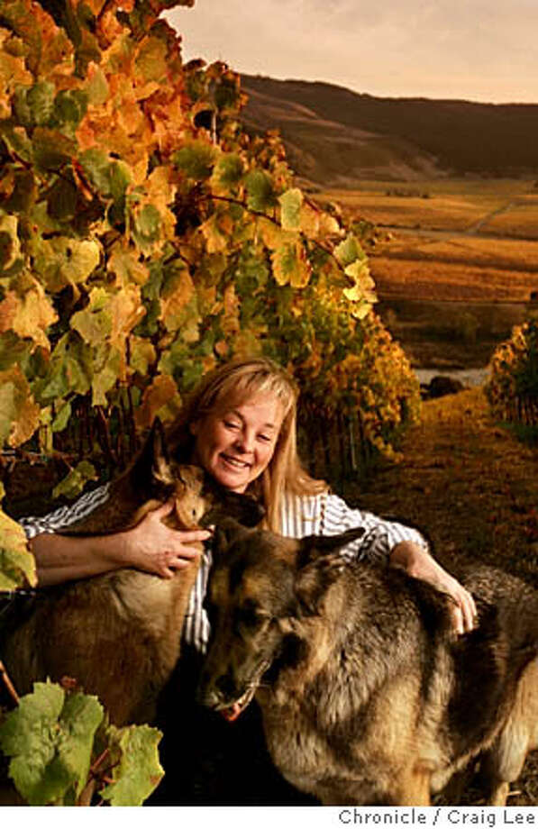 For Wine section's winemaker of the year and others to watch. This is a photo of Kris Curran, winemaker for Sea Smoke Cellars in Lompoc. Some of her dogs are in the photo. As you can see, she loves her dogs.  Event on 11/1/05 in Lompoc. Craig Lee / The Chronicle Photo: Craig Lee