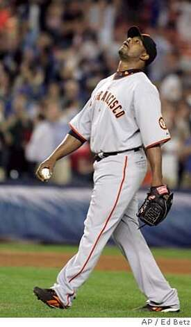 San Francisco Giants' Armando Benitez reacts after he was called with a balk to allow New York Mets Jose Reyes to score during the 12th inning of their baseball game, Tuesday, May 29, 2007 at Shea Stadium in New York. (AP Photo/Ed Betz) Photo: Ed Betz