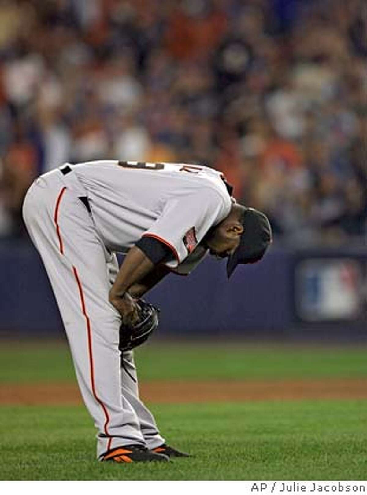 San Francisco Giants' Armando Benitez reacts after committing a balk with Jose Reyes on third base during the 12th inning in Major League Baseball action Tuesday, May 29, 2007 at Shea Stadium in New York. Reyes scored on the balk and Benitez then gave up a home run to Carlos Delgado for the winning run. The Mets won 5-4. (AP Photo/Julie Jacobson)