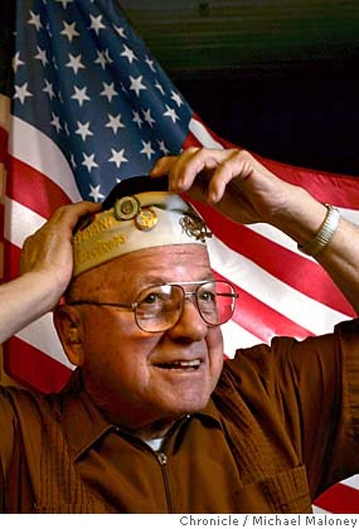 PEARL07_023_MJM.jpg Michael Mickey Ganitch adjusts his Pearl Harbor survivors cap for a portrait in his San Leandro home. Michael Mickey Ganitch of San Leandro is a commander of the disabled veterans of VFW in Oakland and a member of the Pearl Harbor Survivors group at VFW office in Oakland. He and other survivors of the Japanese attack on the U.S. naval base will take part in a ceremony marking the event on Wednesday. Ganitch was on the USS Pennsylvania when it was hit by a 500 pound bomb, killing twenty-three men. Event in San Leandro, CA Photo by Michael Maloney / The Chronicle MANDATORY CREDIT FOR PHOTOG AND SF CHRONICLE/ -MAGS OUT