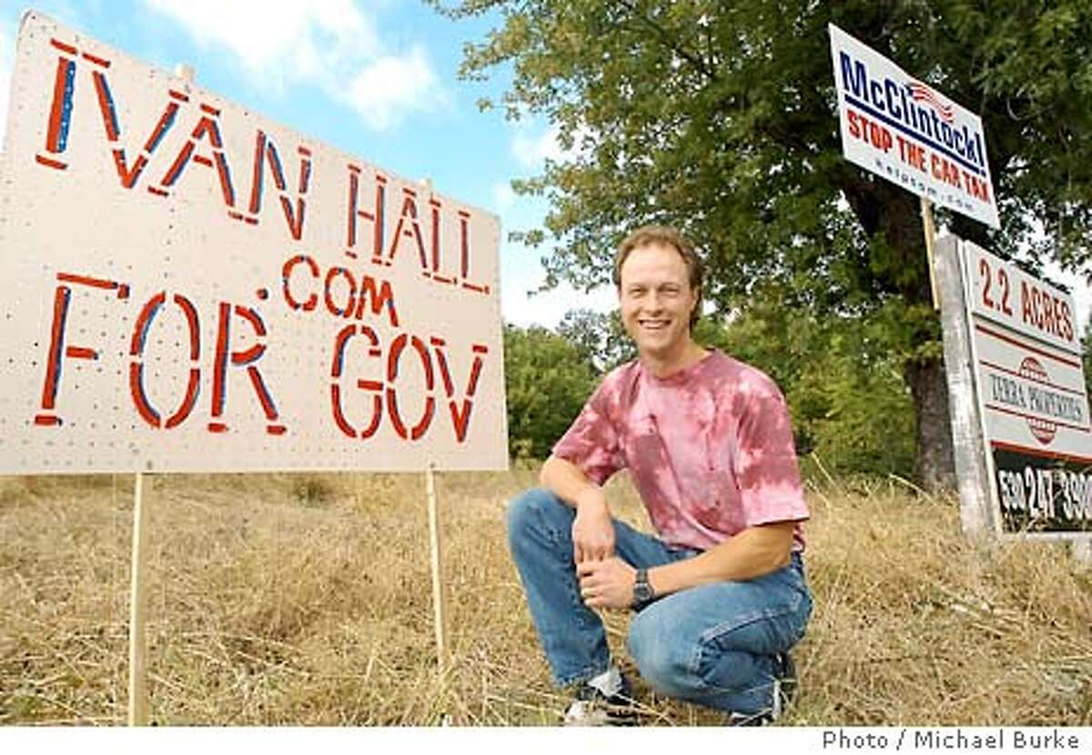 Redding resident Ivan Hall makes false teeth as a profession. He is running for Governer of California in the recall election. On South Bonnyview Road in Redding Ivan Hall's campaign sign is right next to Tom McClintock's sign. (Photo by Michael Burke/special to the chronicle)