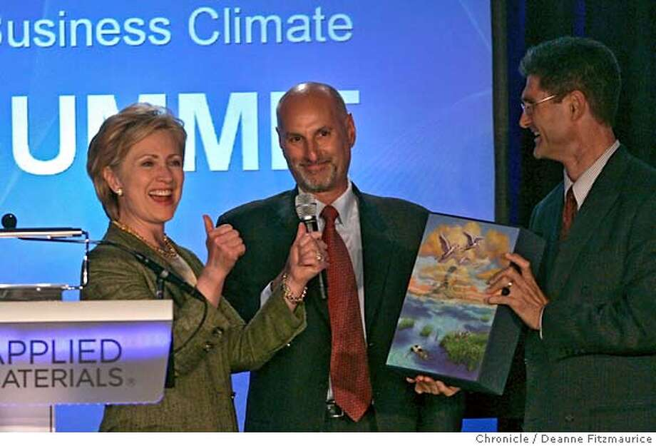 Senator Hillary Rodham Clinton reacts as she is given a bound edition of the Far Side Cartoon book from the Leadership Group. Bruce Chizen, CEO Adobe Systems, Inc is at center and Carl Guardino, CEO LEadership Group after Clinton delivers the keynote speech at the 4th Annual CEO Business Climate Summit at Applied Materials. Deanne Fitzmaurice / The Chronicle Photo: Deanne Fitzmaurice