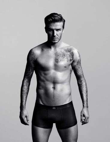 David Beckham models a design of his own: boxers  in black.  Photo: H&M, Courtesy