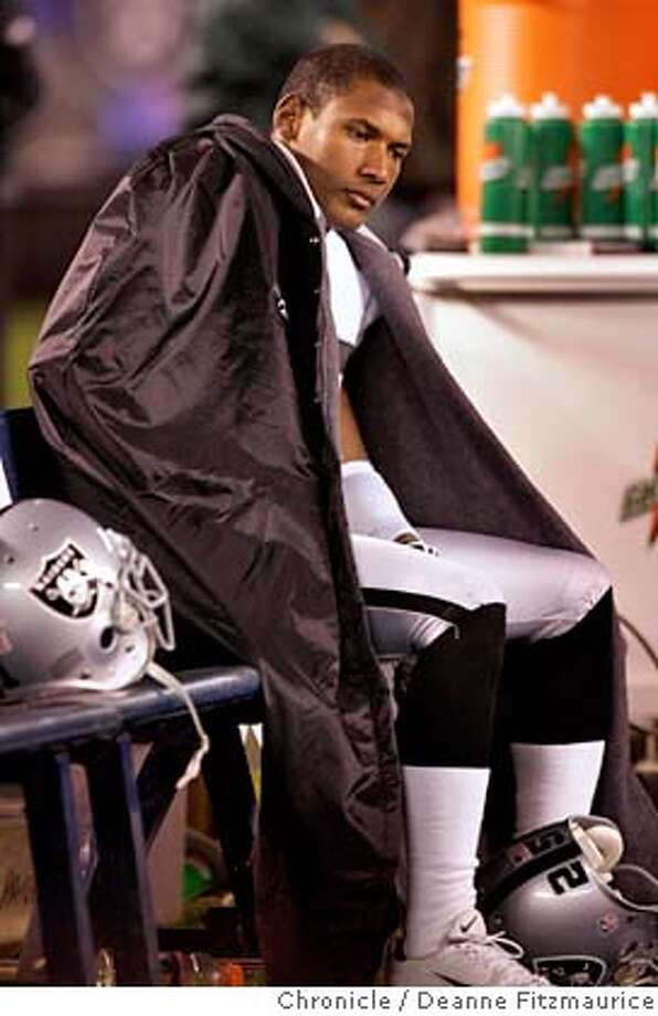 raiders_687_df.JPG  Denard Walker sits on the bench during the final minute of the game. The Oakland Raiders play the San Diego Chargers at Qualcomm Stadium in San Diego.  Event in San Diego on 12/4/05.  Deanne Fitzmaurice / The Chronicle Photo: Deanne Fitzmaurice