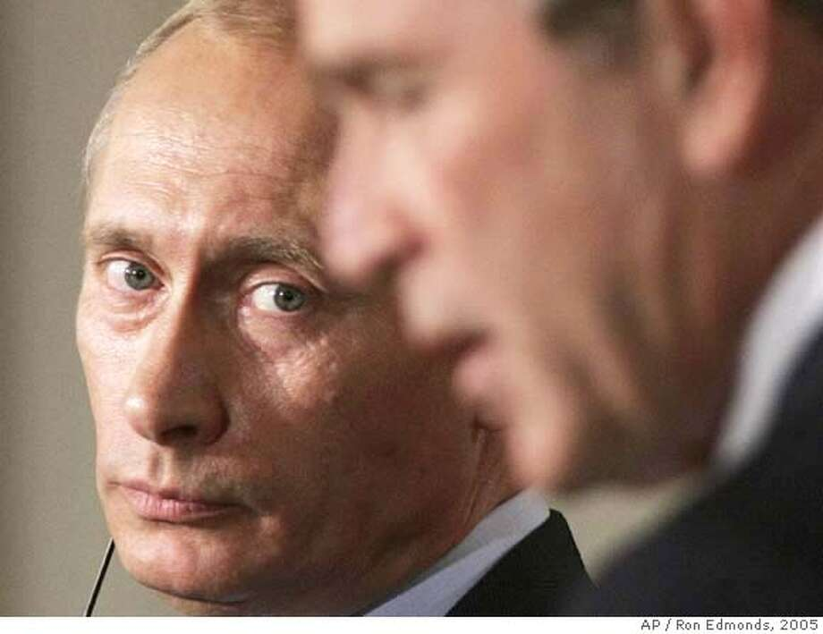** FILE ** Russian President Vladimir Putin, left, listens to President Bush during their joint news conference after their meeting in the Oval Office at the White House in this Sept. 15, 2005 file photo. The warm partnership Bush hoped for six years ago between the old Cold War superpowers has soured with suspicions, misunderstandings and perceived hurts on both sides. (AP Photo/Ron Edmonds, File) Photo: RON EDMONDS
