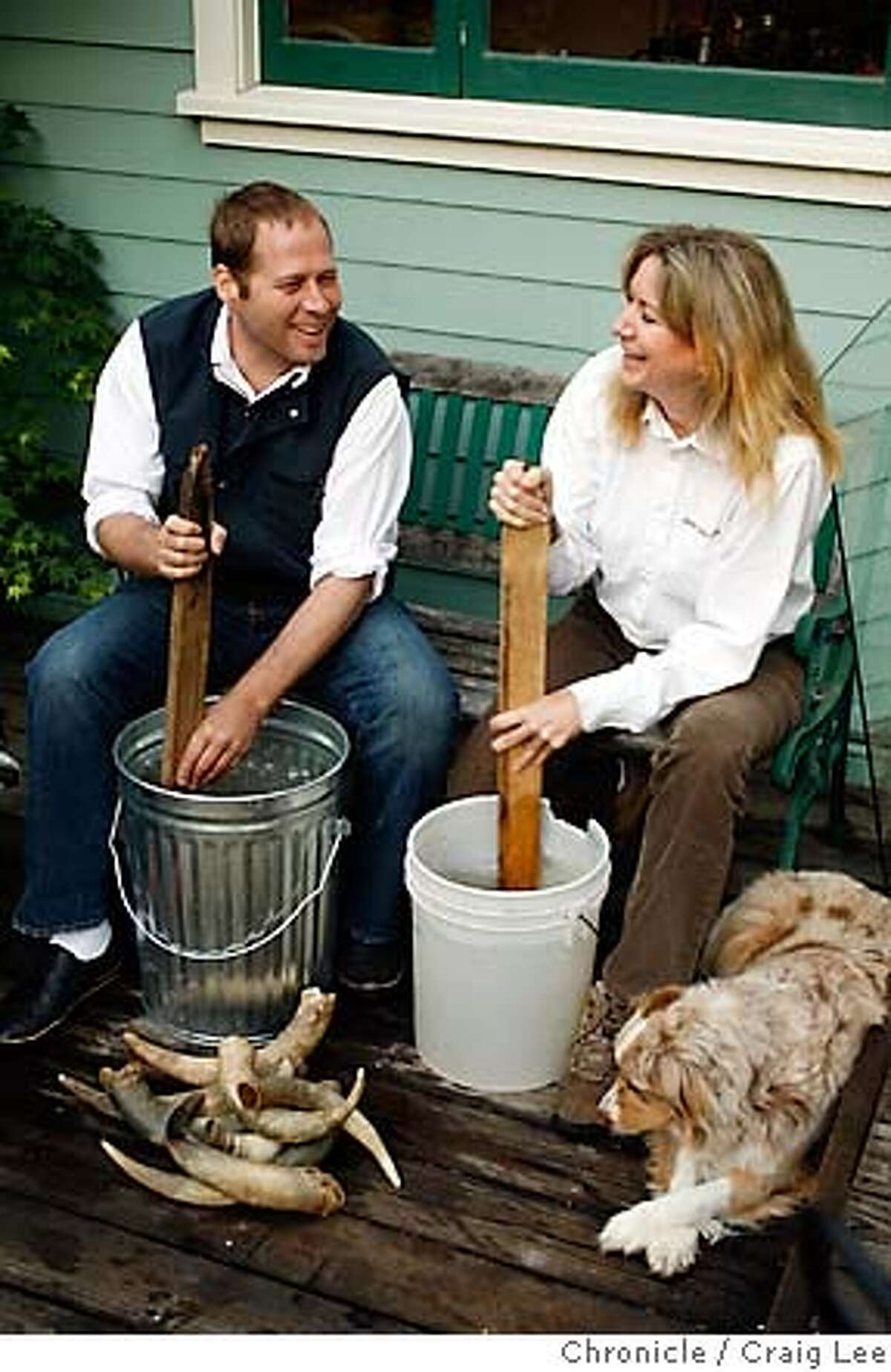 BIODYNAMIC16_046_cl.JPG Story on chefs who have their own biodynamic farms to supply their restaurant. This is David Kinch, chef at Manresa in Los Gatos. David and his farmer, Cynthia Sandberg of Love Apple Farm in Ben Lomond, apply a biodynamic preparation to the crops. Photo of Cynthia Sandberg (right) and David Kinch (left) stirring rain water captured in buckets to make the biodynamic preparation. Cynthia's dog, Indy, is on the right. Event on 4/27/07 in Ben Lomond. photo by Craig Lee / The Chronicle MANDATORY CREDIT FOR PHOTOG AND SF CHRONICLE/NO SALES-MAGS OUT