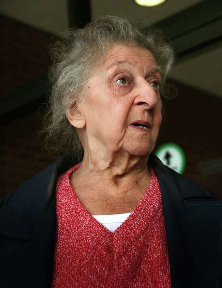Marion Perreira, 90 of Stratford, exits Bridgeport Superior Court on Tuesday, January 3, 2012. After violating an agreement with the town to vaccinate her cats, Perreira was charged with animal cruelty on Tuesday, Jan. 17, 2012. Photo: Brian A. Pounds / Connecticut Post