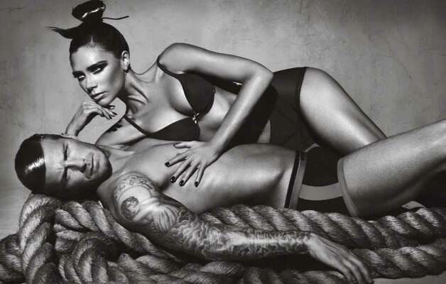 David and Victoria Beckham are experienced at this underwear business. Here the not-shy couple pose for another ad. Photo: Giorgio Armani, Courtesy